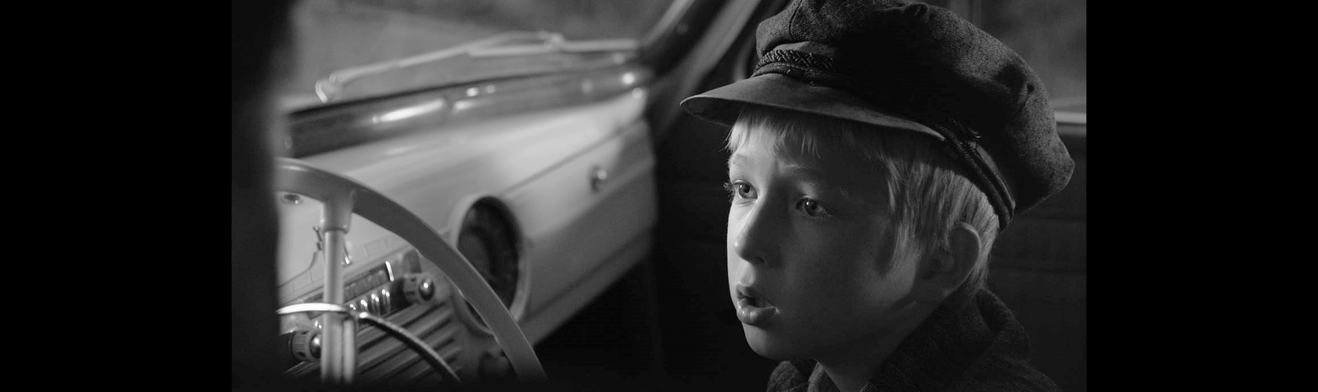 Young boy sitting in a car